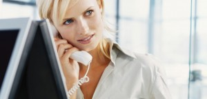 businesswoman talking on a landline phone in an officestk309018rkn